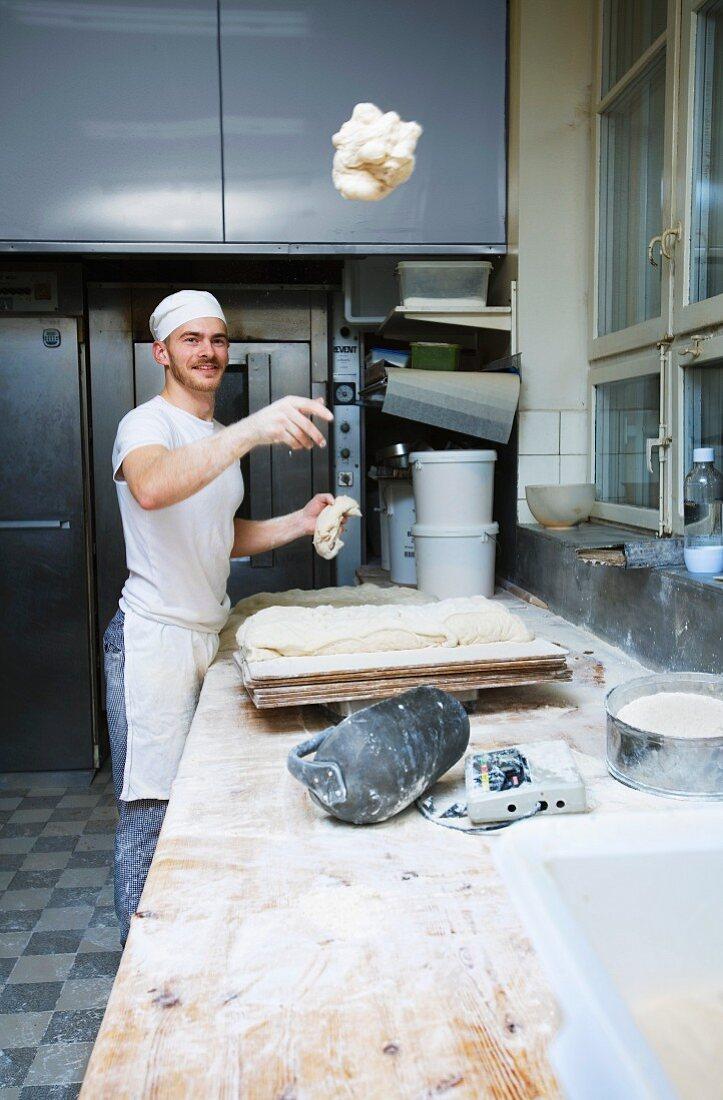 A baker in a bakery, Sweden.