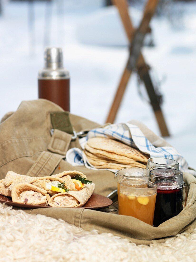 Close-up of picnic food at winter