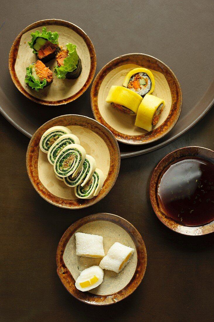 Sticky rice and mango rolls, nori sushi, mango sushi and tofu skin sushi