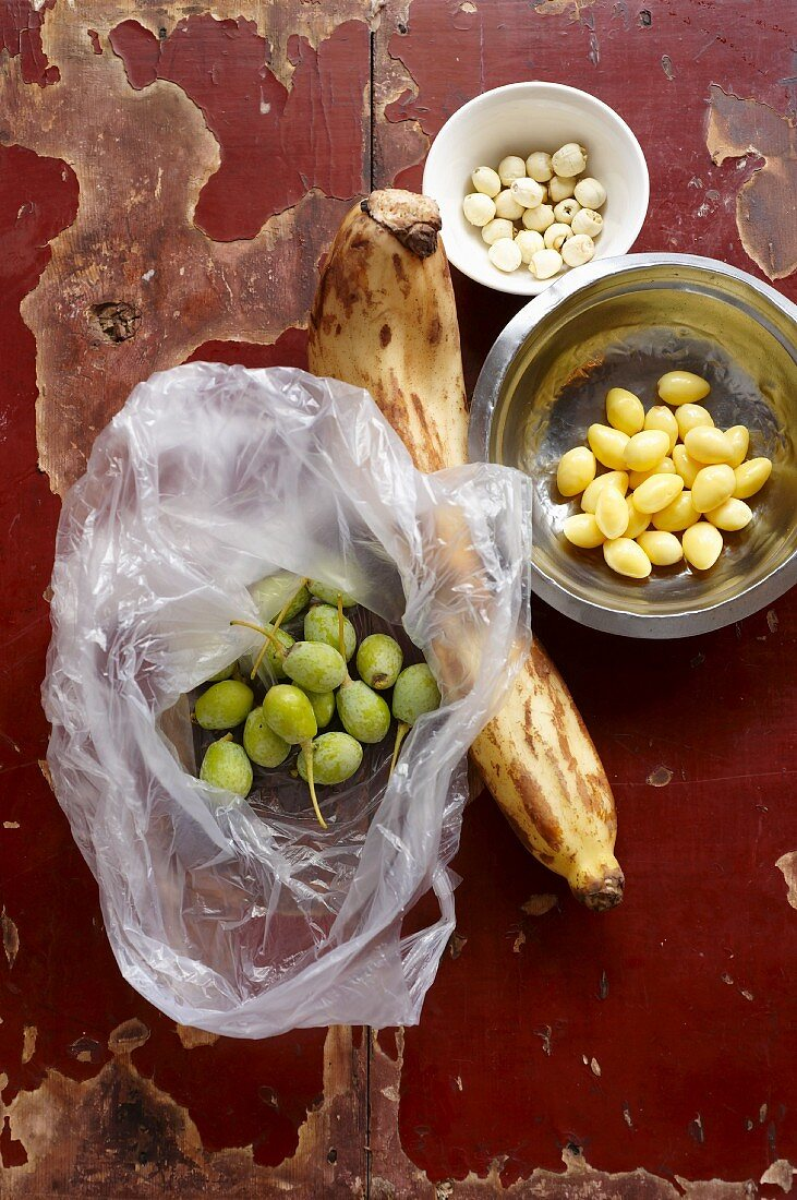 Fresh gingko fruits, dried lotus seeds, shelled and pre-cooked gingko seeds and a lotus root
