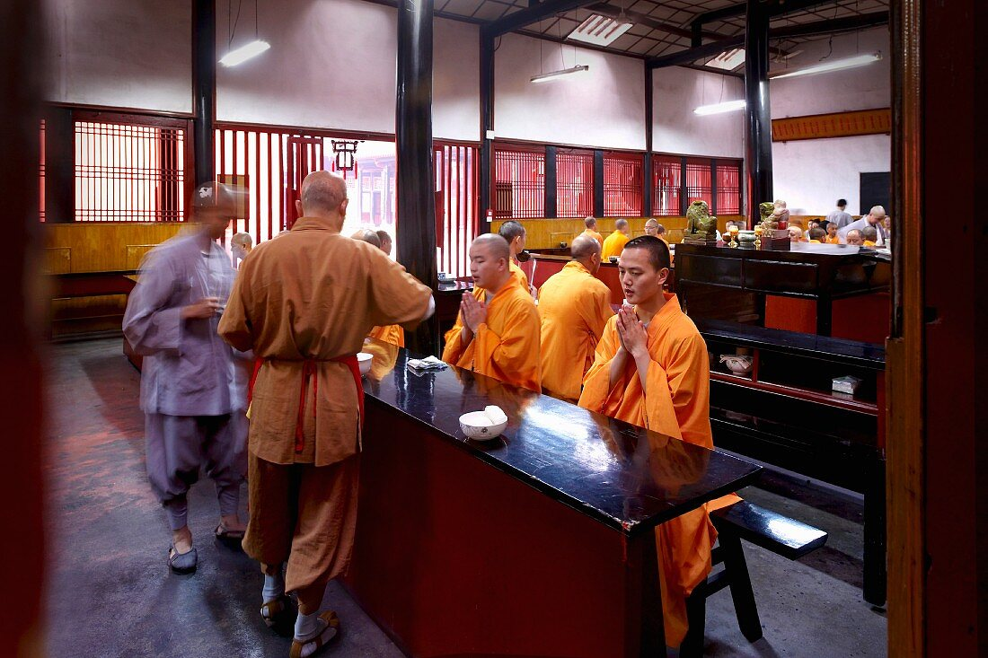 Monks sitting at a dining table