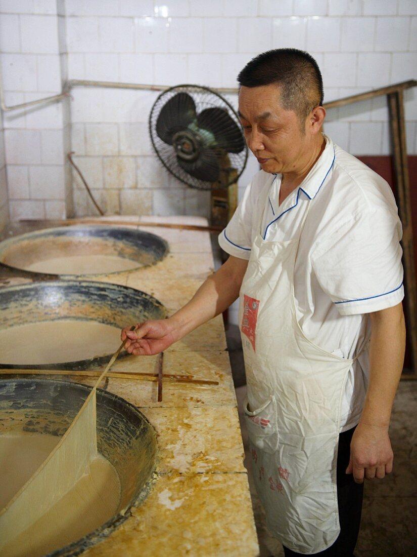 A Chinese chef making tofu skins