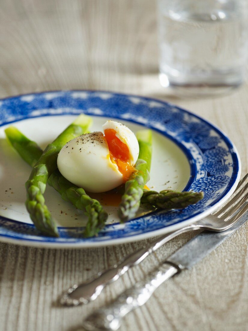 Green asparagus with a boiled egg