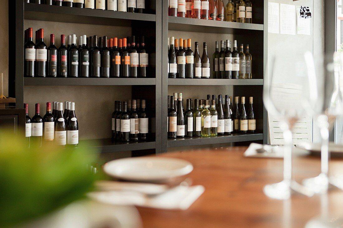 Wine bottles on shelves in restaurant