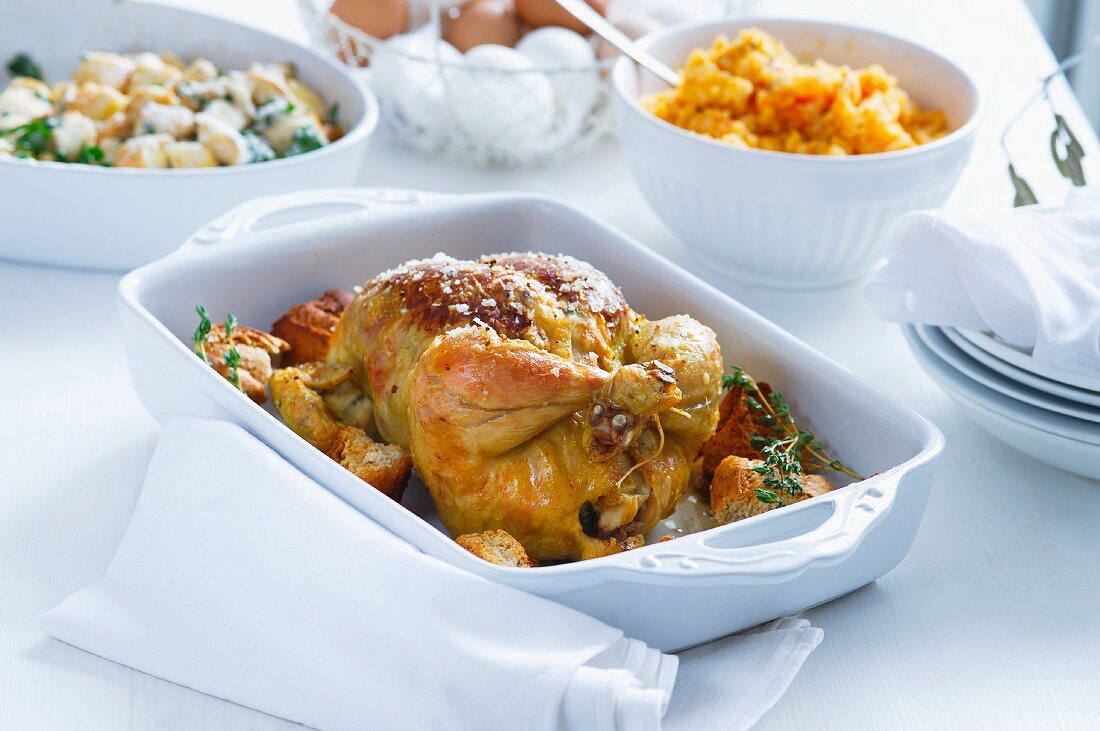 Roast chicken with roast potatoes, carrots and vegetables