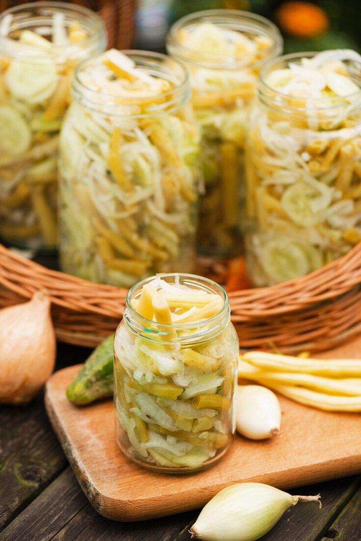 Bean and cucumber salad with onions, preserved in jars