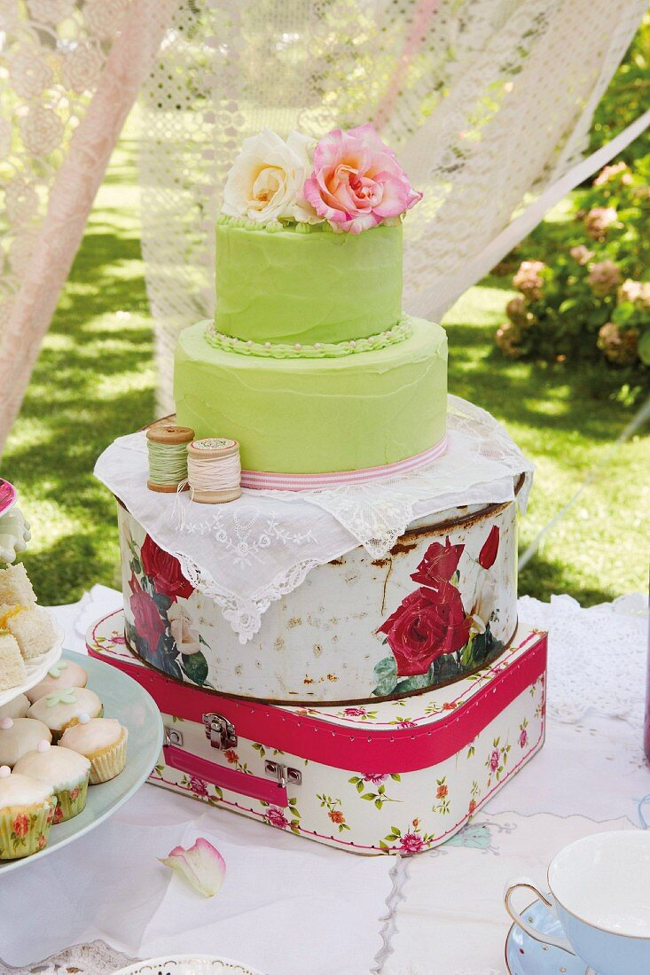 A vintage children's birthday party in a garden with tea, cake and biscuits