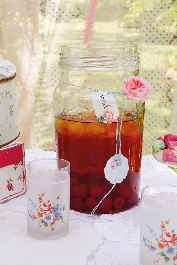 A vintage children's birthday party in a garden with berry iced tea