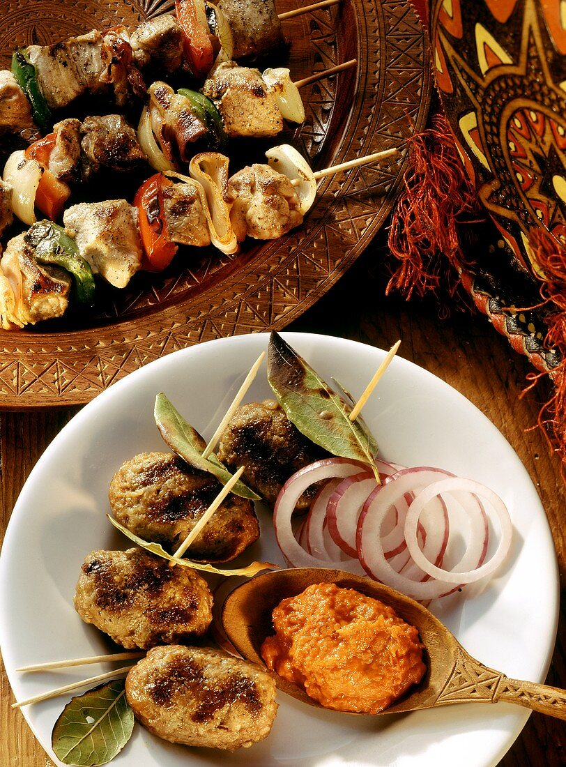 Raznici (meat kebabs) and Cevapcici (mince sausages)