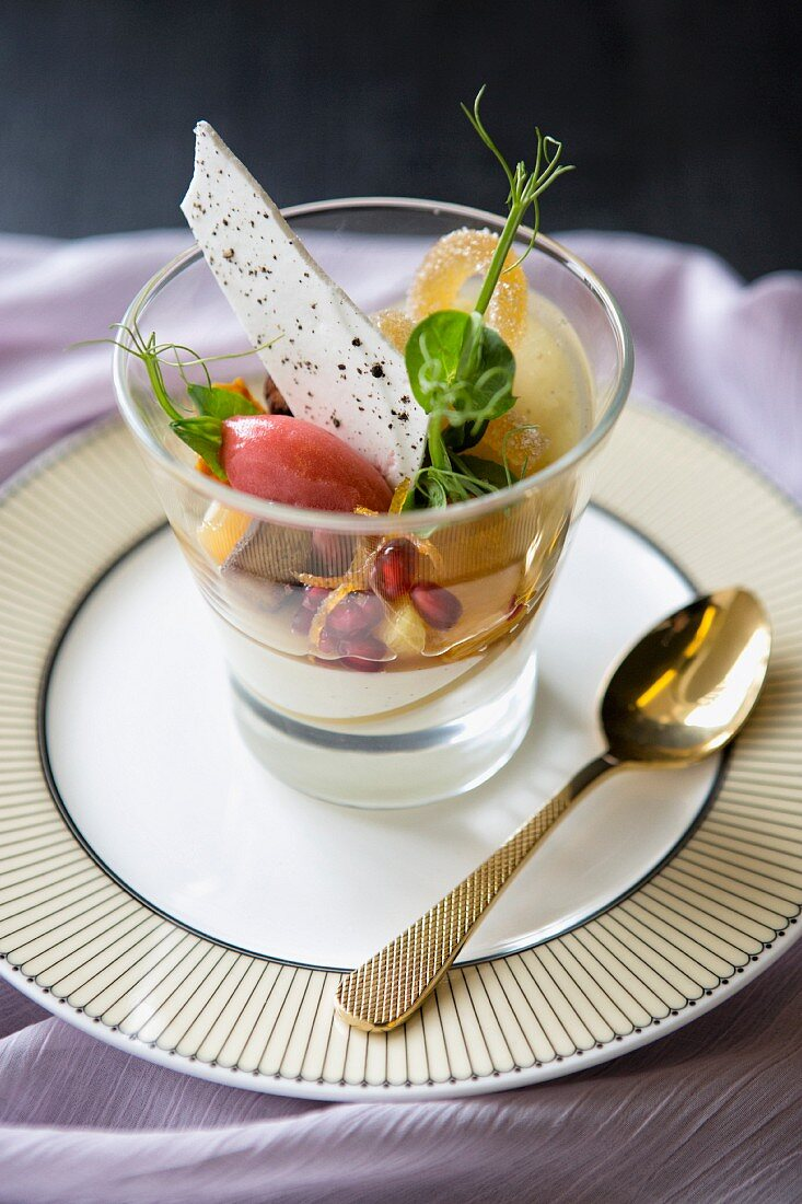 Lemon desert with a pomegranate salad and berry sorbet