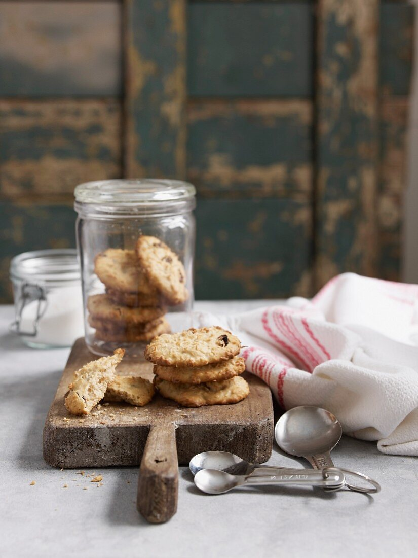 Cookies in a storage jar on a chopping board