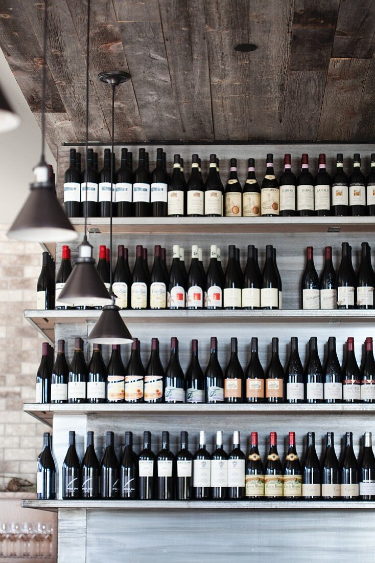 Many Assorted Bottles of Wines on Shelves