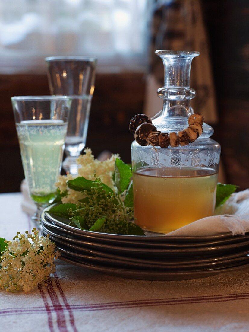 A carafe of elderflower syrup