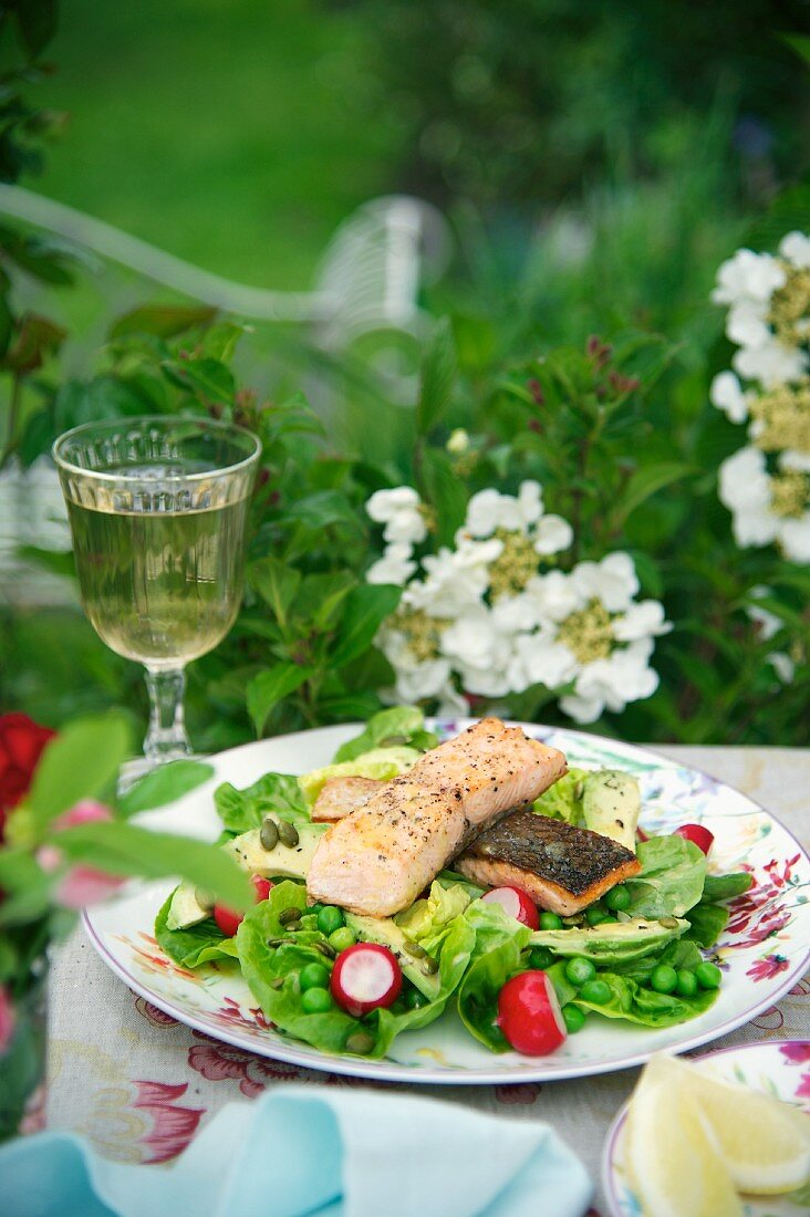 A large spring salad with salmon
