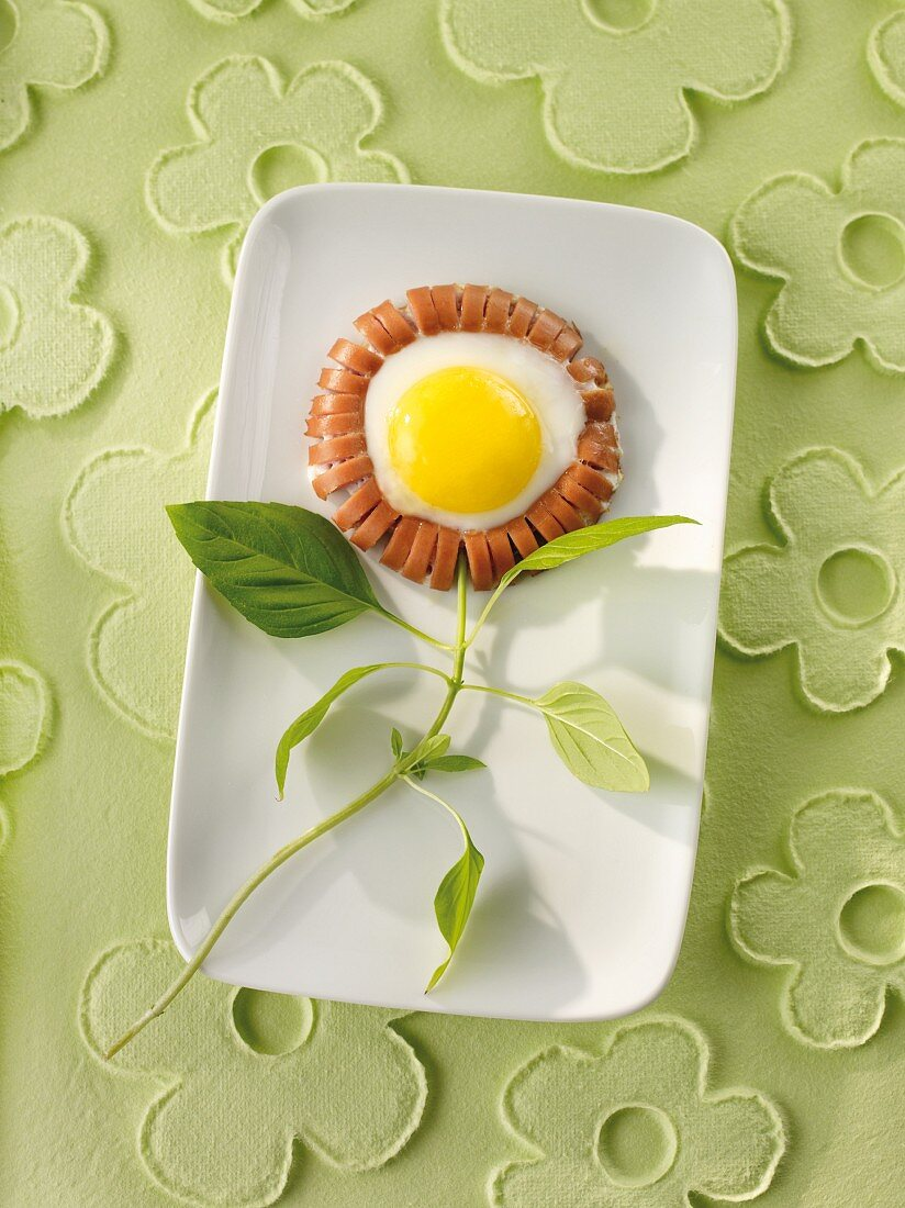 A sausage flower with a fried egg