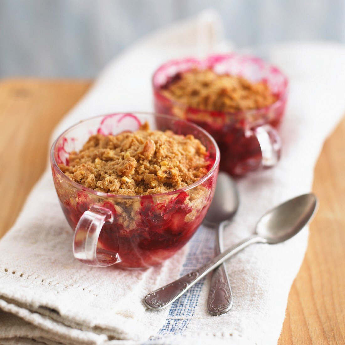 Boysenberry-apple crumbles in glass tea cups