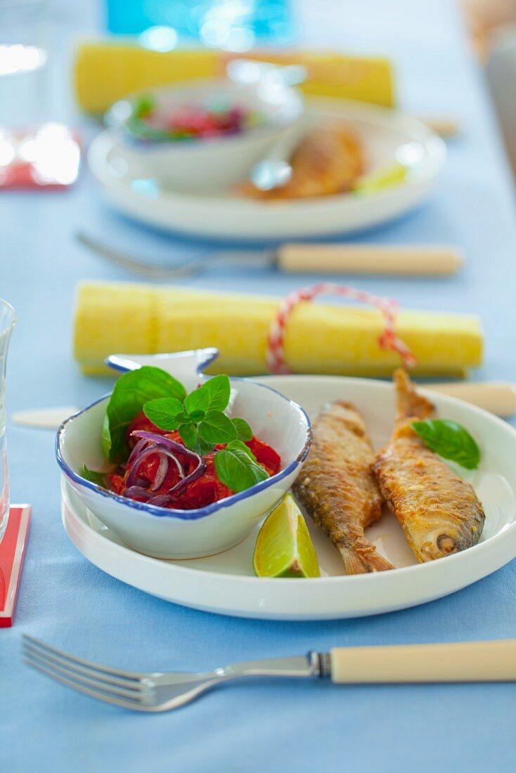 Deep-fried fish with tomato salad