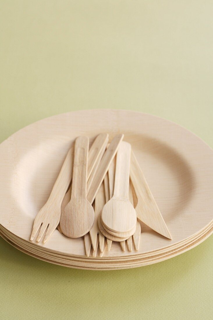 A Stack of Bamboo Plates and Flatware