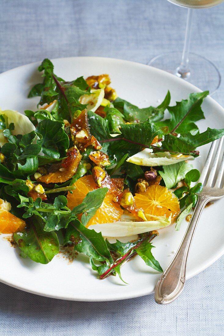 A Salad of Dandelion Greens, Pistachio Brittle, Mandarin Oranges and Endive