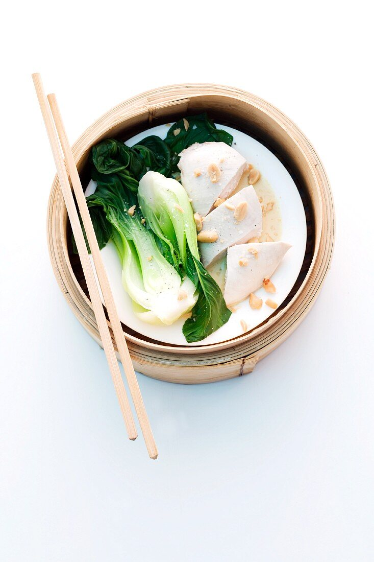 Chicken breast with pak choi cooked in a steaming basket