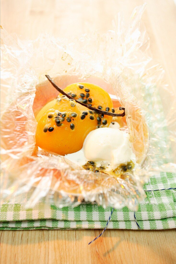 Peach baked in foil with passion fruit, vanilla and rosemary ice cream