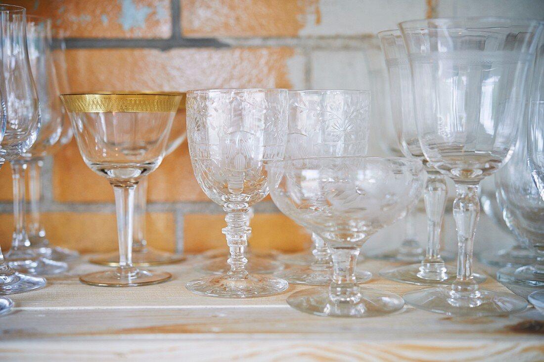 vintage cocktail glasses on shelf