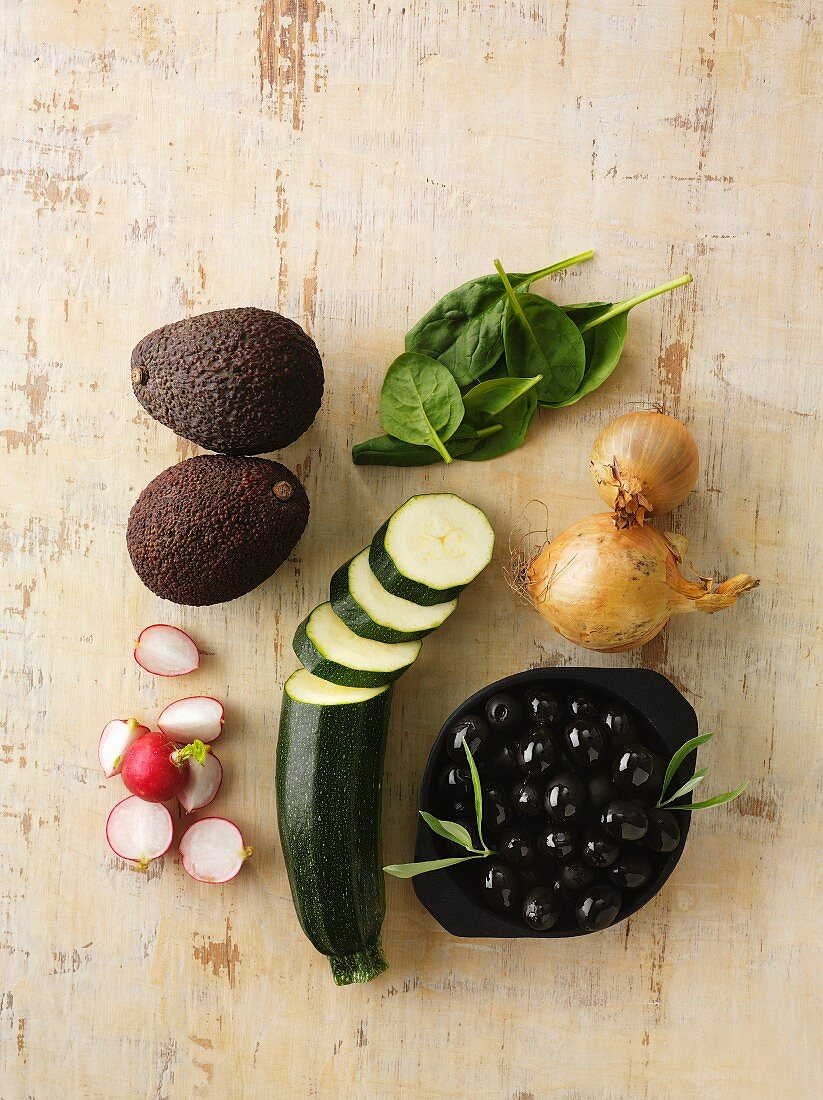 Assorted types of vegetables on a wooden surface