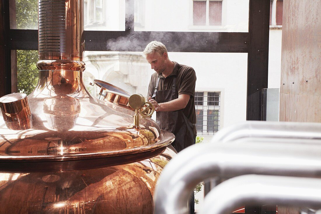 A worker in a brewery