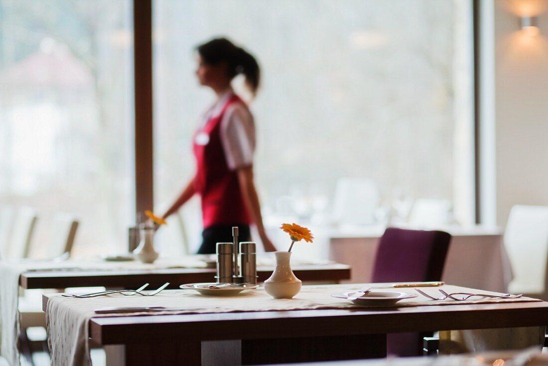 A waitress walking through the restaurant