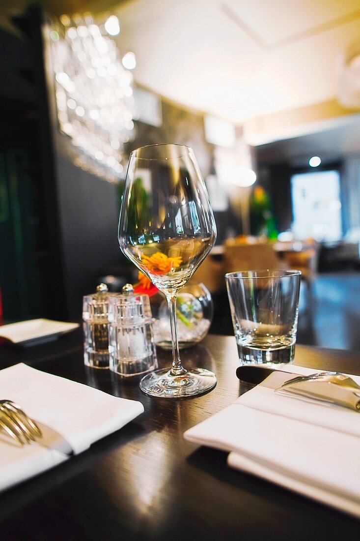 interior of the restaurant, focus on a wine glass