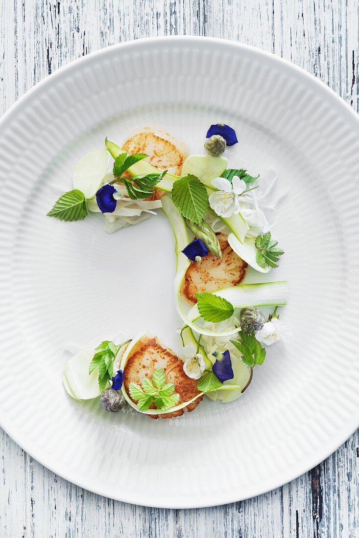 Fried scallops, green asparagus, summer cabbage and beech leaves.
