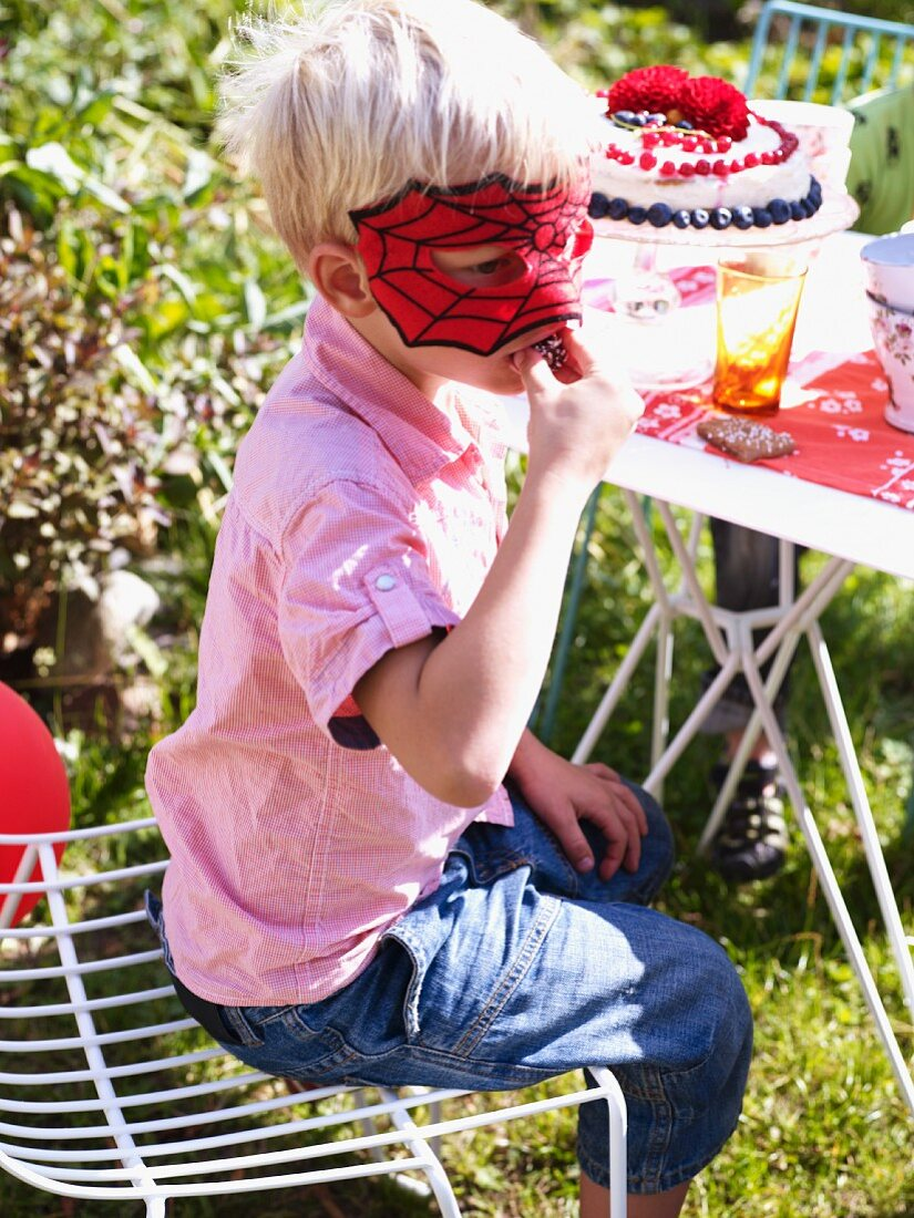 Boy wearing mask at party