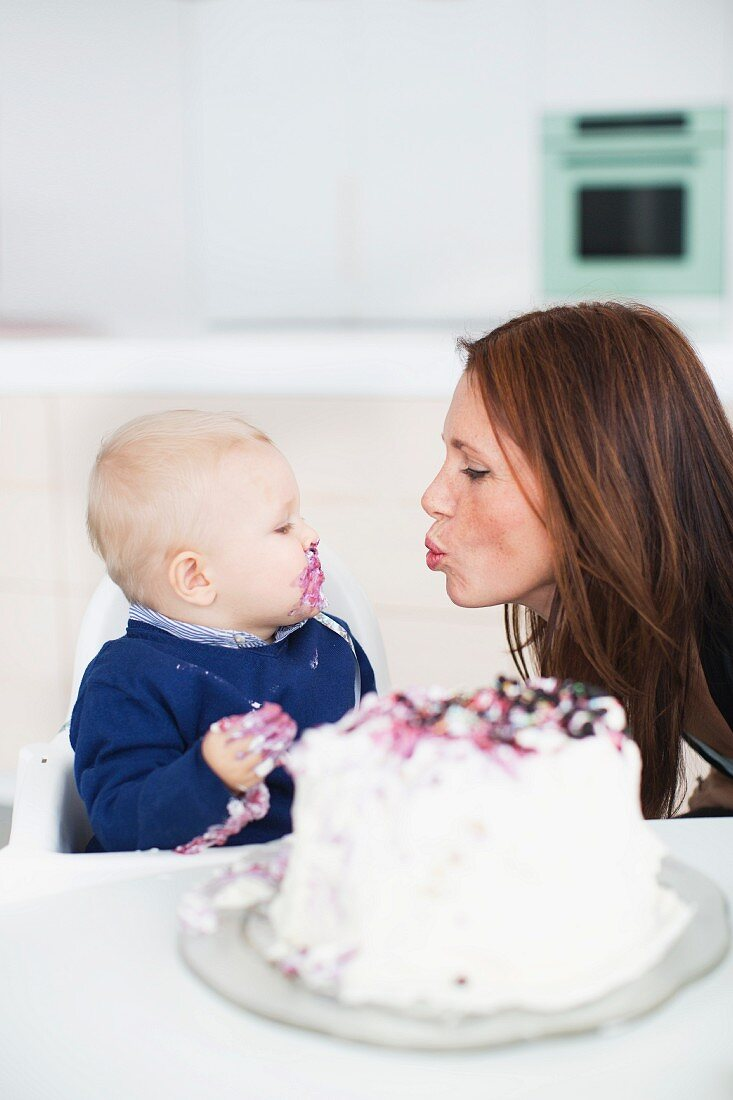 Boy with mother celebrating first birthday