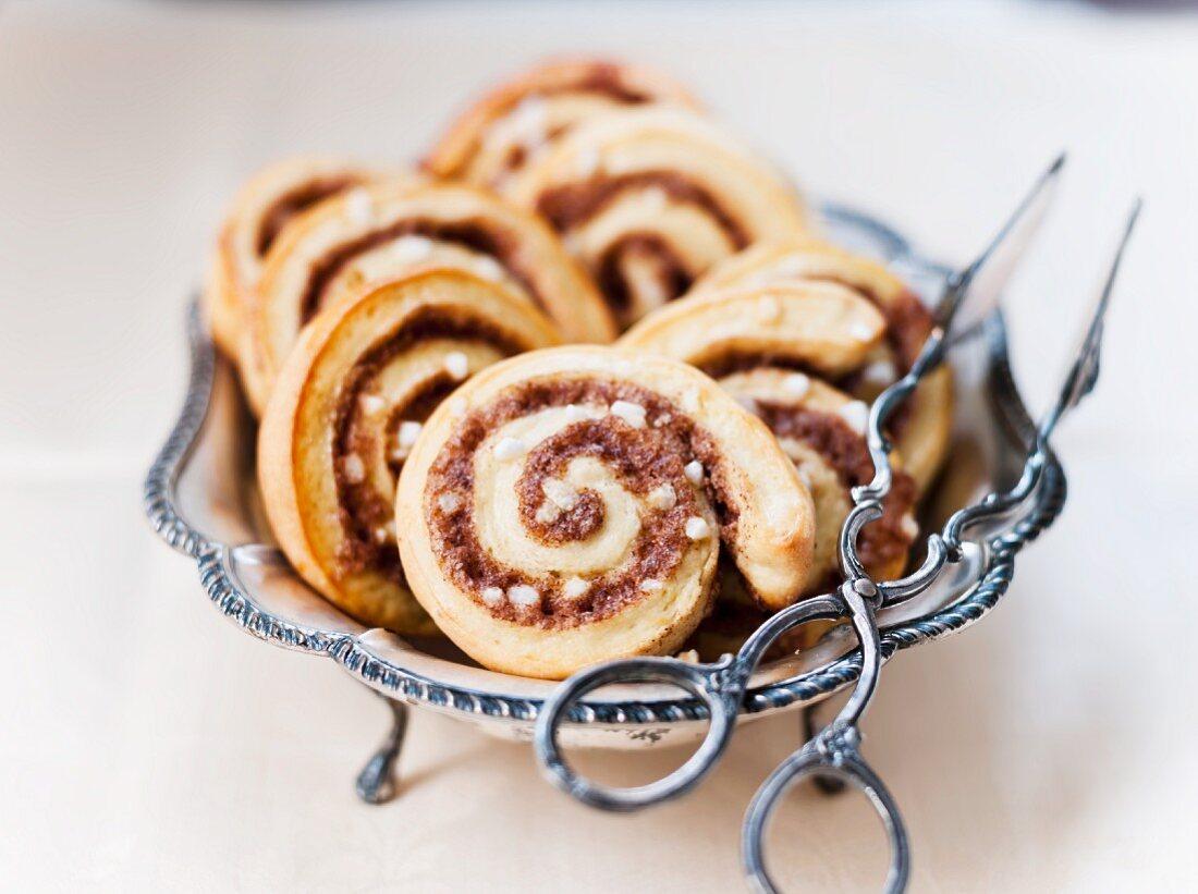 Cinnamon Danish pastries with pastry tongs