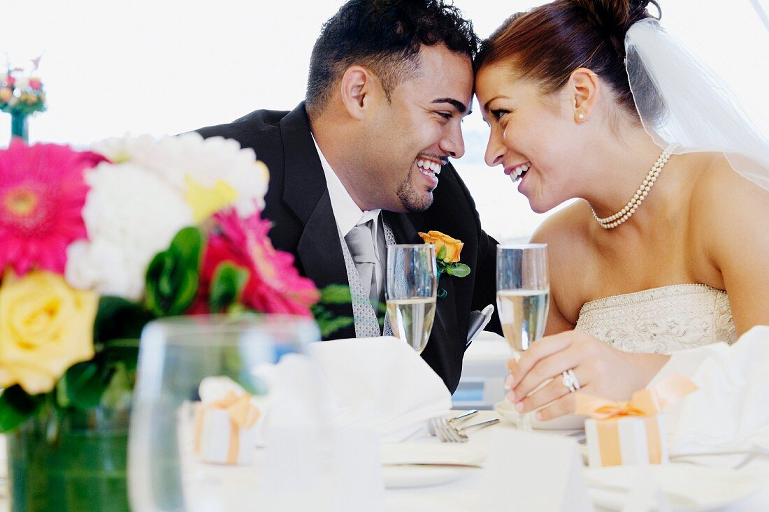 Multi-ethnic bride and groom smiling at each other