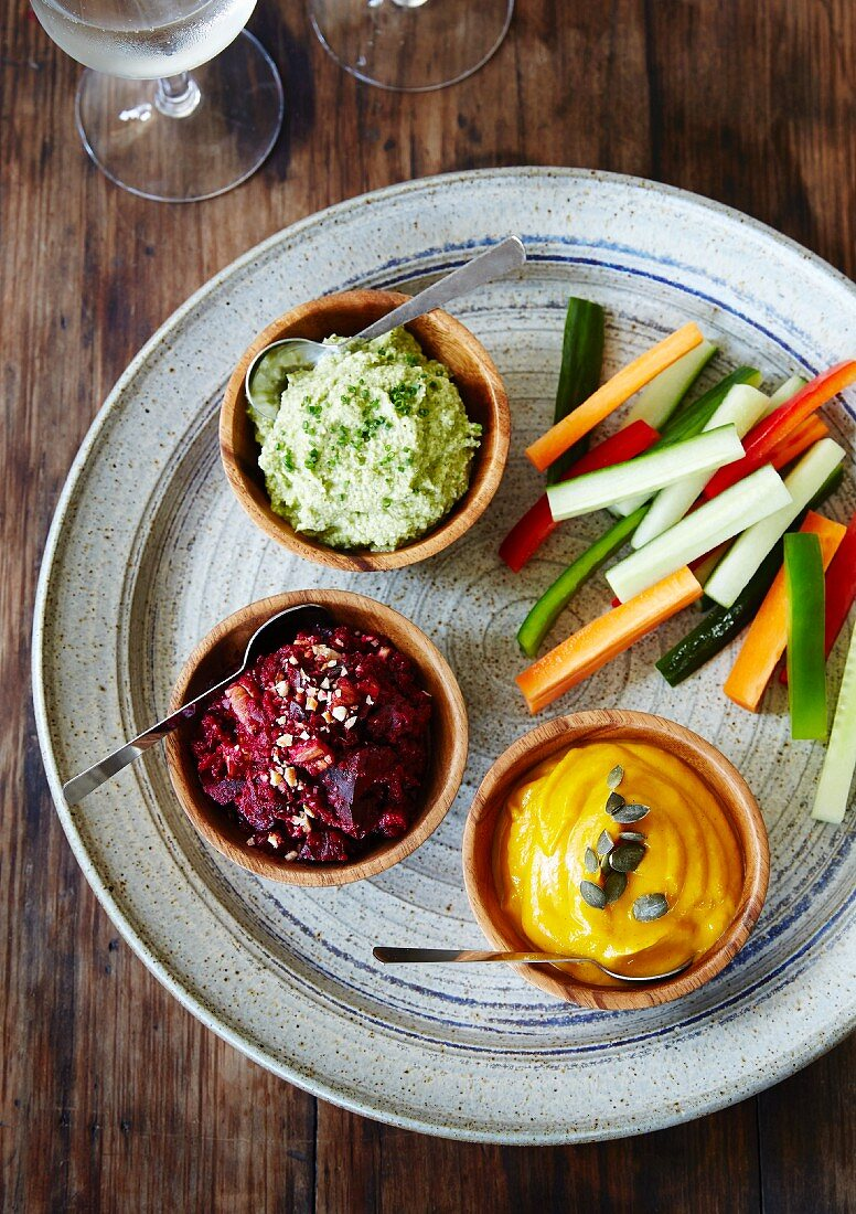 Assorted dips (spinach, beetroot, squash) with vegetable batons