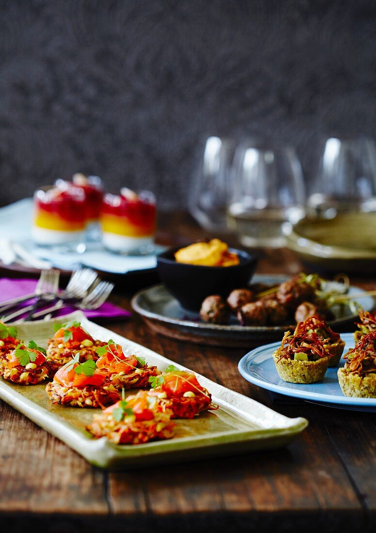 Assorted party nibbles on a wooden table