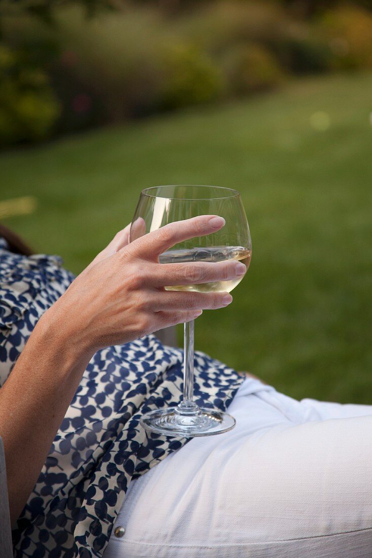 Woman Holding Glass of Wine, Close-Up
