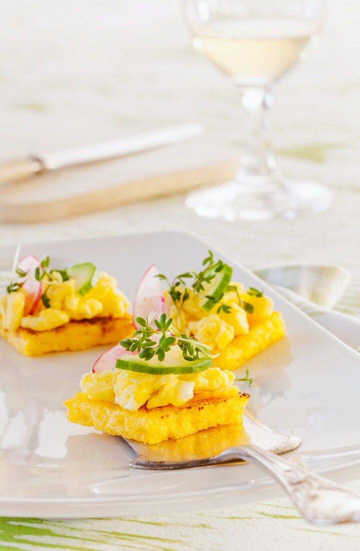 Polenta squares with egg, cucumber, radish and cress