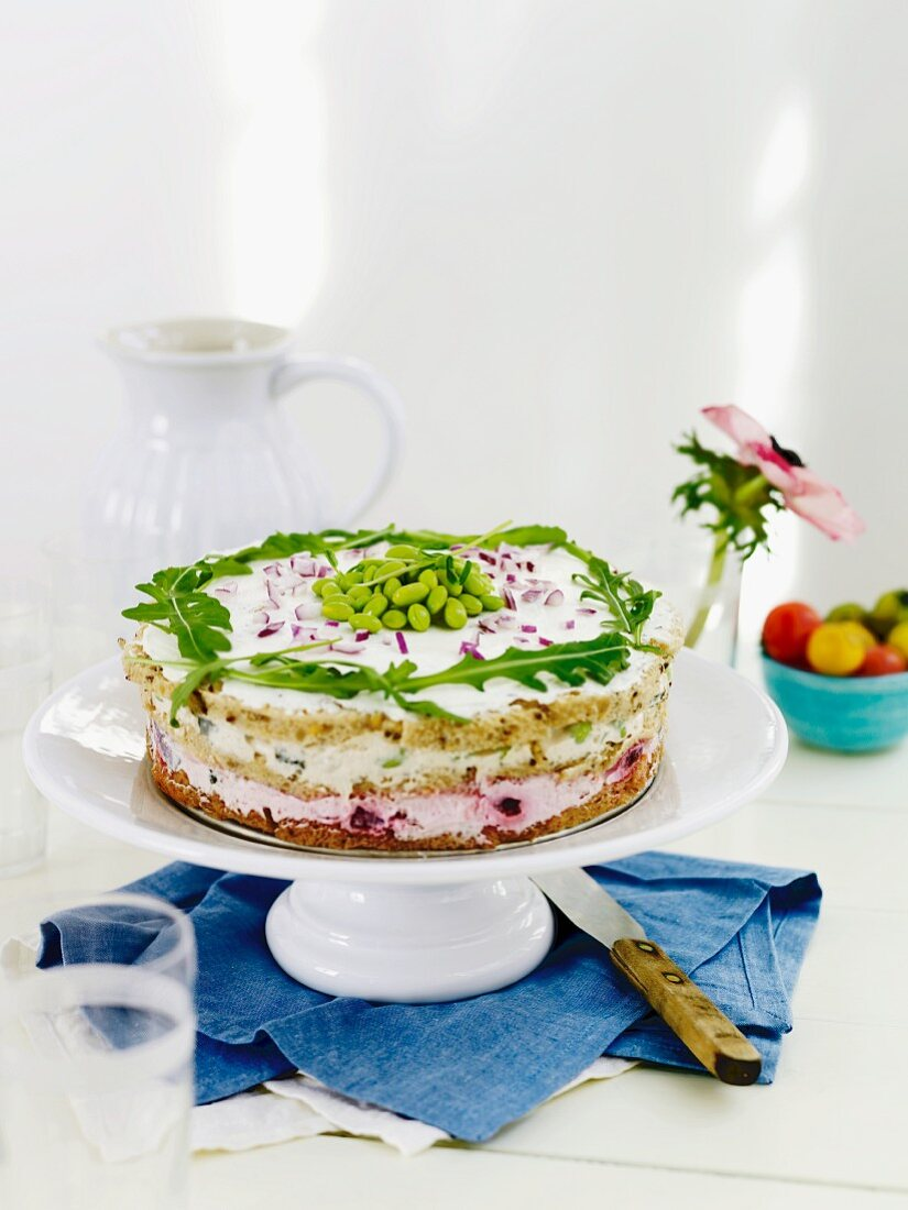 Sandwich cake with vegetables and rocket