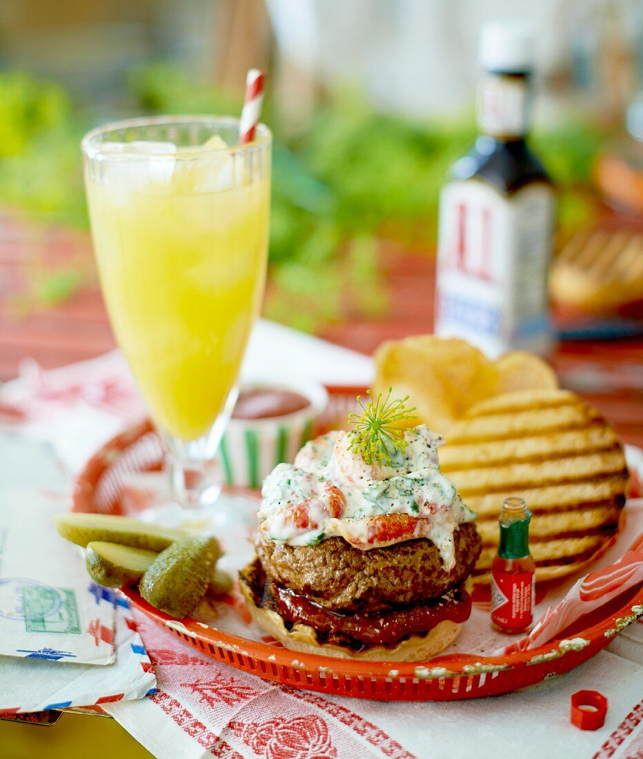 A hamburger with crayfish, gherkins and crisps