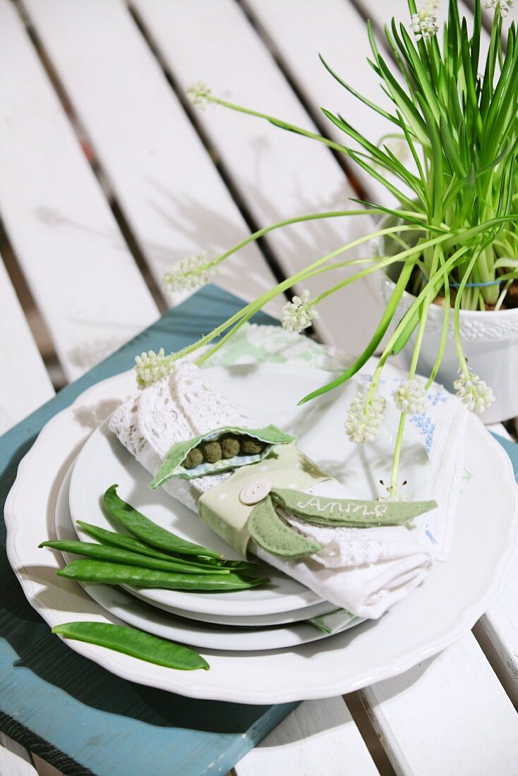 Place setting with mange tout pods and felt name tag