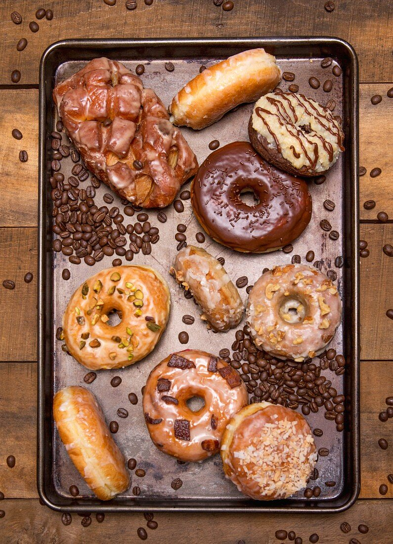Assorted Glazed Donuts on Cookie Sheet, High Angle View
