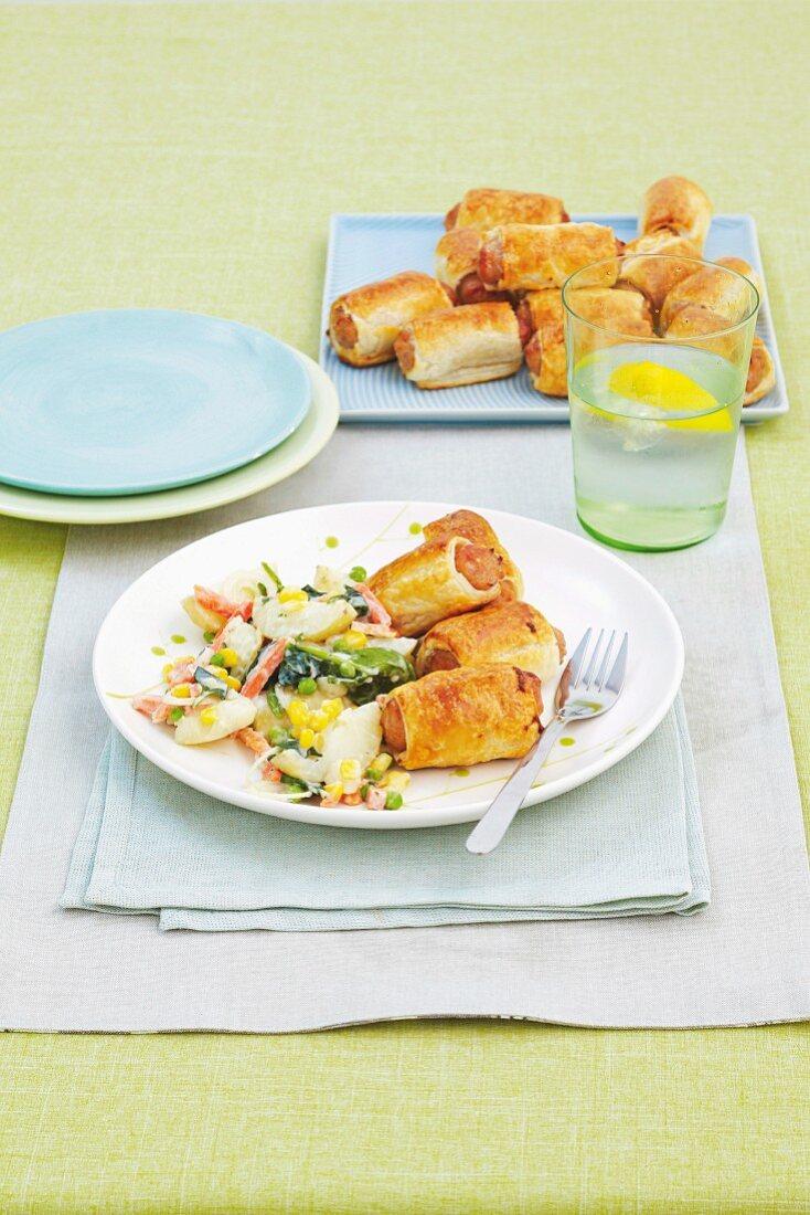 Easy sausage rolls with potato salad