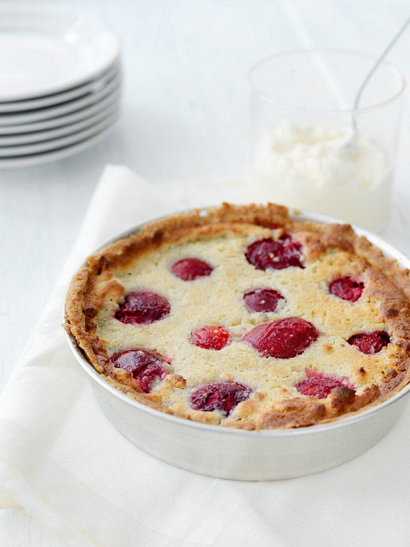 A plum pie in a baking dish
