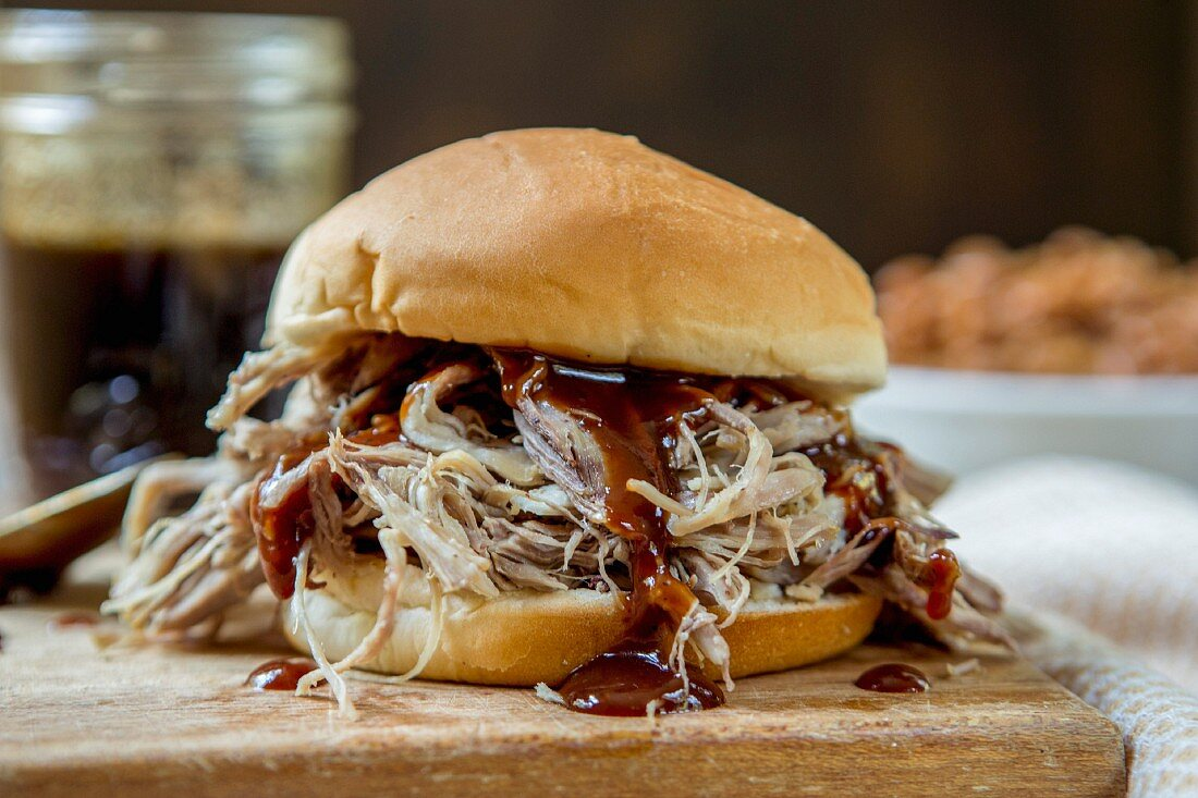A pulled pork sandwich with barbecue sauce