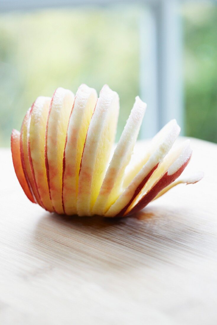 A red apple, peeled and sliced