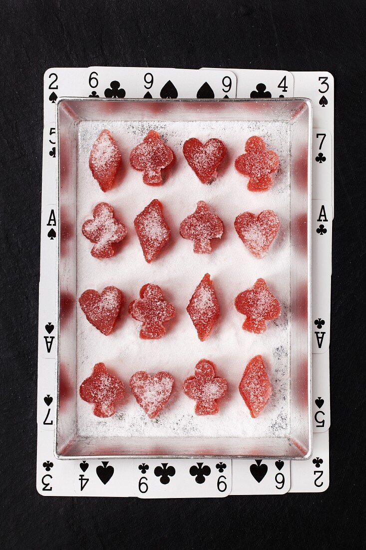 Plum fruit jellies cut into hearts, diamonds, clubs and spades shapes