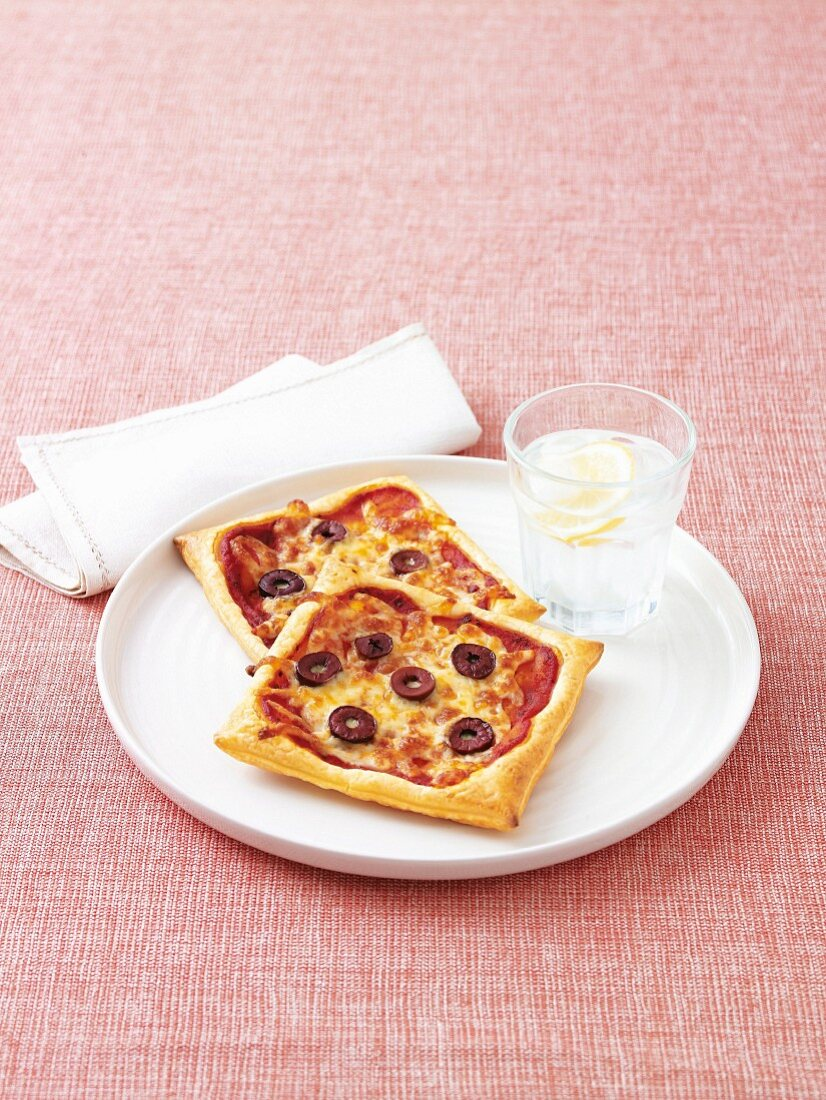 Puff pastries with olives and mozzarella