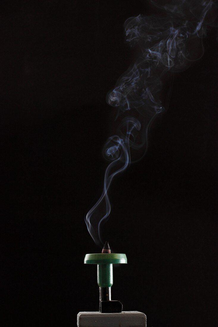 A smoking incense cone